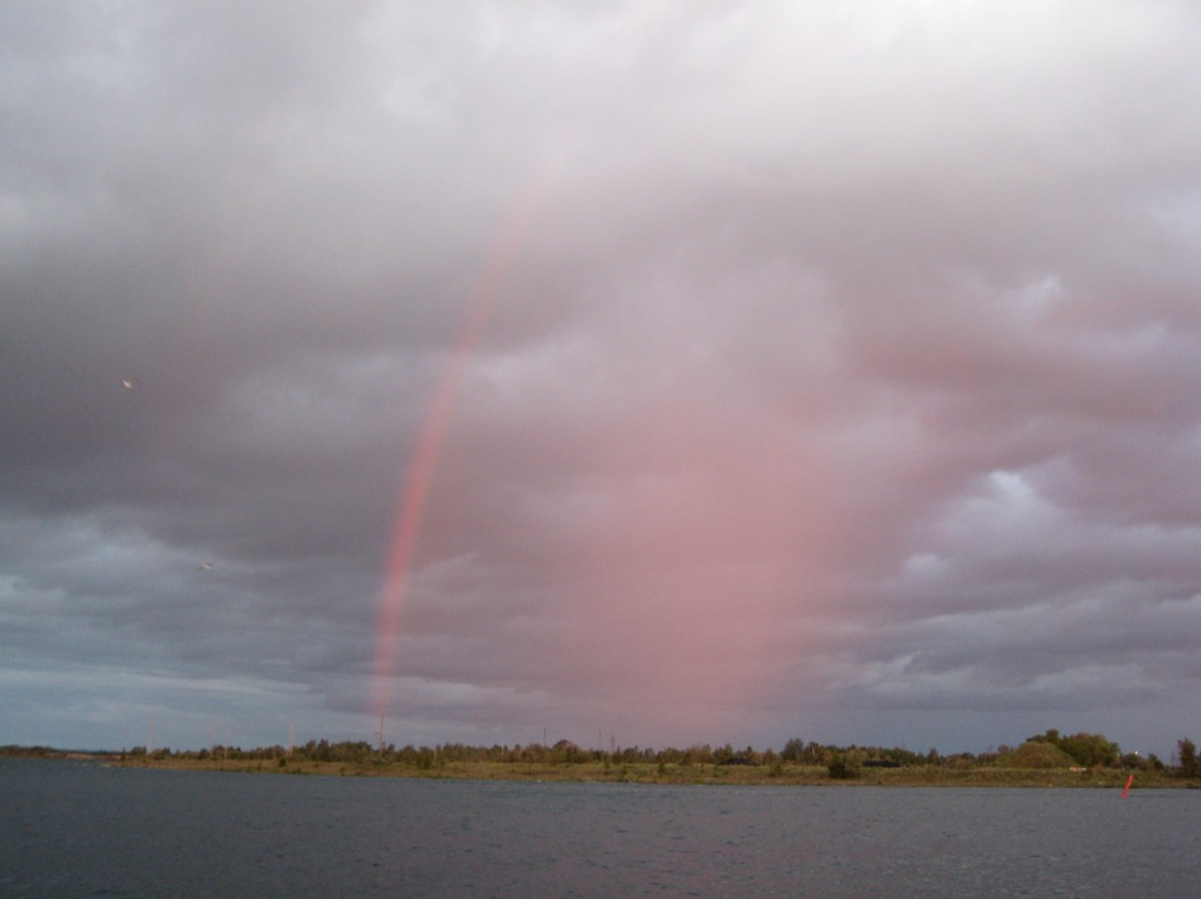 A bow of rain opposite last evening's sunset.