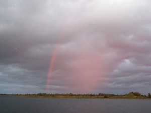 A bow of rain opposite last evening's sunset.