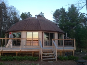 The round house, designed by my dad. It's a modified geodesic dome, and its 14 panels and roof were built by my dad in our garage in Grand Rapids. They fit together perfectly when the last panel was inserted!