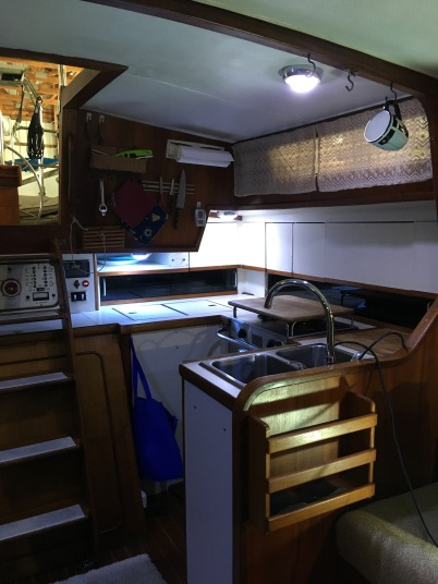 Looking aft to galley area with lots of storage